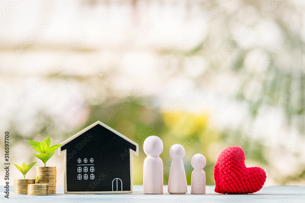 Fototapeta Family and red heart and blackboard house and stacked gold coin with growing put on the wood in the garden, Loan for business investment real estate or saving money for buy home to one's love concept.