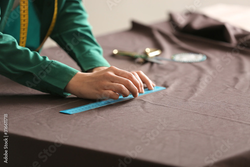 Young woman sewing clothes in atelier Canvas Print