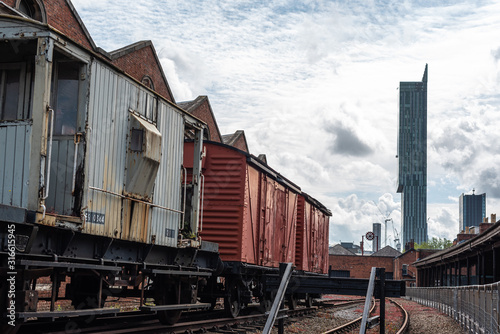 Leinwand Poster time machine travel past future meet old new train locomotive beetham tower muse