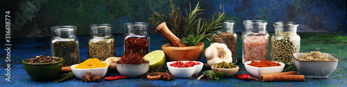Spices and herbs on table Fototapete
