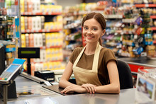 Young Adult Woman Cashier On C...