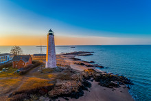 Lighthouse And Oyster Boat At Sunrise On New Haven Harbor