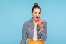 Delighted Beautiful Woman With Hair Bun Looking At Delicious Doughnut With Desire, Keeping Her Mouth Opened And Dreaming To Bite Eat Sweet Donut, Temptation Of Sugary Confectionery. Indoor Studio Shot