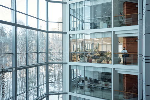 Interior of contemporary multi-floor business center with large windows Canvas Print