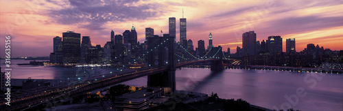 This is the Brooklyn Bridge over the East River and the Manhattan skyline at sunset Wallpaper Mural