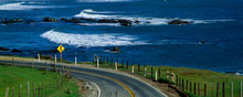 This Is Route 1, Also Known As The Pacific Coast Highway. The Ocean Is To The Right Of The Road Which Curves Around A Bend.