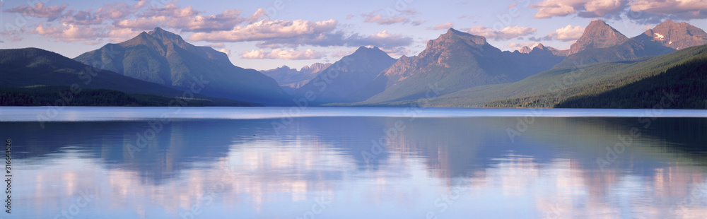 Fototapeta This is Lake McDonald. The surrounding mountains are reflected in the lake.