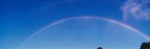 This Is A Rainbow Against A Blue Sky With A Few White Clouds. It Was Taken Near Niagara Falls.