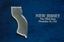 This Is A Silver Map Of The State Of New Jersey Against A Blue Background. It Says, New Jersey, The Third State, December 18, 1787, Which Is The Date It Entered The Union.