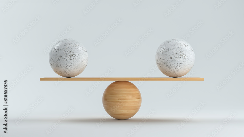 Fototapeta wooden scale balancing two big balls in front white background