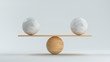 canvas print picture - wooden scale balancing two big balls in front white background
