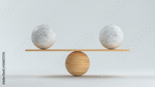 Canvas Print wooden scale balancing two big balls in front white background