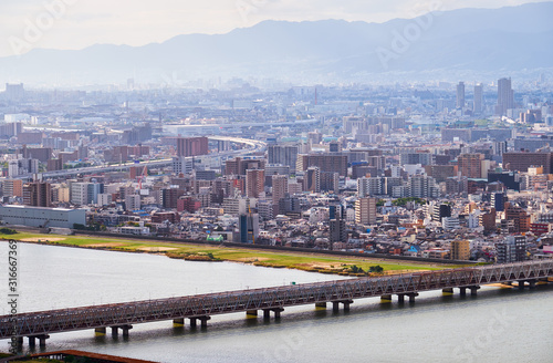 Cuadros en Lienzo The birds eye view of Osaka city with Yodo River. Japan