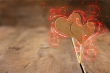 Valentines Day Concept. Two Hearts Over Wooden Background And Glitter Lights