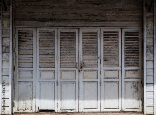 The image for making a background or a black drop in a retro style of an Asian old wooden house painted in white Wallpaper Mural