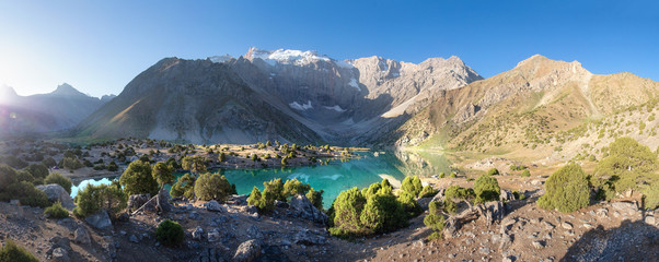 Beautiful scenery of mountain lake. Kulikalon lake in Fann Mountains, Tajikistan. Sunrise in summer day