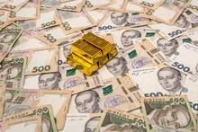 Stacks Of Gold Bars On Ukraine Moneu Uah . Top View