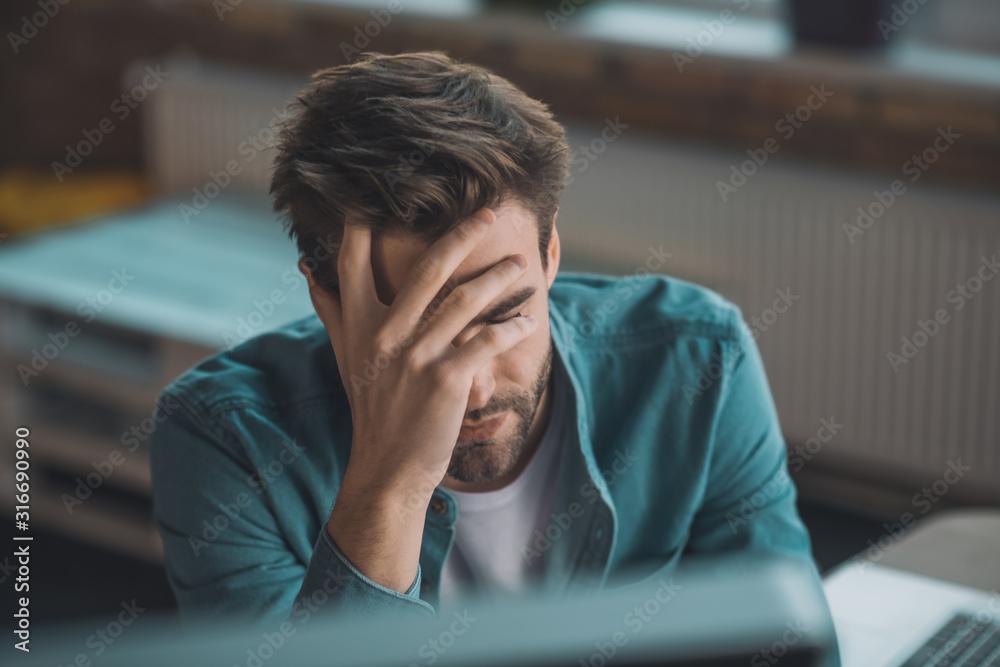 Fototapeta Portrait of a tired sad young man