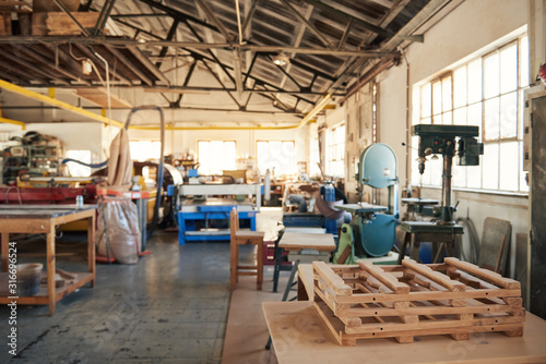 Obraz Interior of tools and machinery in a woodworking shop - fototapety do salonu