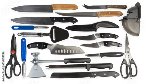 Kitchen knives for different purposes, peelers, ax, scissors, knife sharpener Fototapet