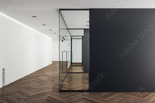Office interior with blank black wall.
