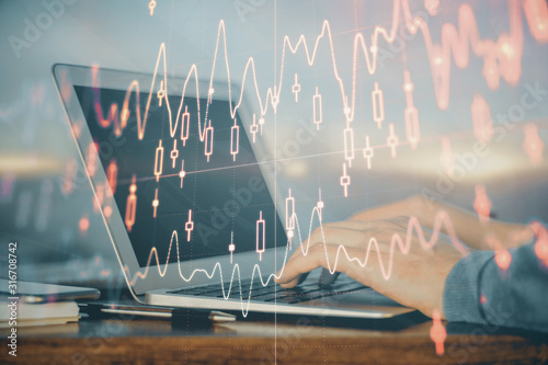 Fototapeta Double exposure of stock market graph with man working on laptop on background. Concept of financial analysis. obraz