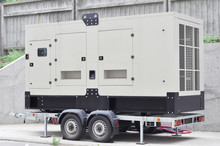 Industrial Generator Power. Mobile Diesel Backup Generator On Caravan Wheels.  Backup Power Supply Generator For Emergency.