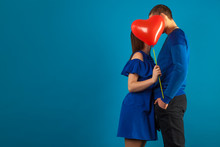 Young Couple In Love On A Blue...