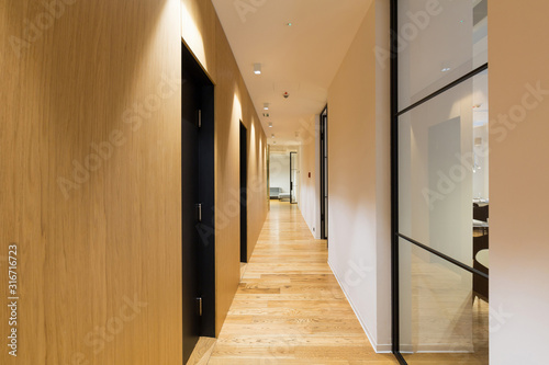 Interior of a long hotel corridor, doorway Canvas Print