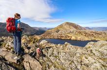 A Female Hiker On The Summit O...