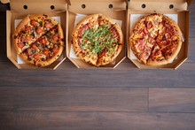 Three Different Kind Of Pizzas...