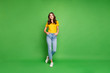canvas print picture - Full length body size view of her she nice attractive lovely cheerful cheery content wavy-haired girl holding hands in pockets isolated over bright vivid shine vibrant green color background