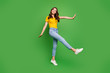 Full length body size view of her she nice attractive lovely charming cheerful cheery girlish wavy-haired girl walking having fun isolated on bright vivid shine vibrant green color background