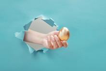 Hand Gives Golden Egg Through ...
