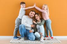 Portrait Of Happy Family Near ...