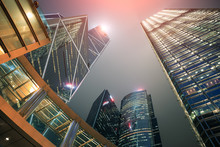 Bank Of China Tower Building. That Skyscraper In Hong Kong City With Modern Architecture Exterior Design. Night Sky Reflection With Glass Of Window. Center Of Corporate, Business, Financial Service.