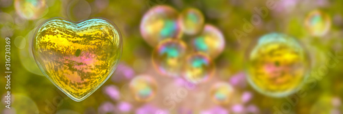 Soap bubble in the shape of a heart on panoramic green nature background. Love and Valentine's day web banner