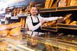 Seller offering fresh loaf of bread