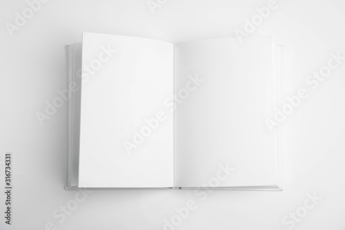 Fotografía Open book with blank pages on white background, top view