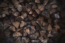 Background Of Dry Firewood Logs In A Pile