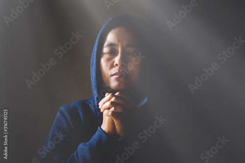Woman Pray for god blessing to wishing have a better life. Canvas Print