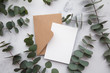 canvas print picture - Blank white card and envelope with eucalyptus leaves. Blank invitation.