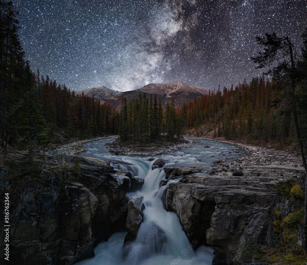 Fototapeta Sunwapta Falls with Milky way in autumn at Icefields Parkway, Jasper national park