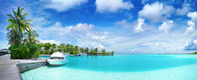 White Boat At Pier With Palm Trees, Maldives Island. Beautiful Panoramic Tropical Landscape With Turquoise Ocean And Blue Sky With Clouds.