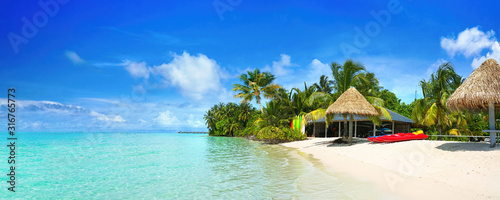 Beautiful beach with white sand, turquoise ocean and blue sky with clouds on Sunny day Fototapeta