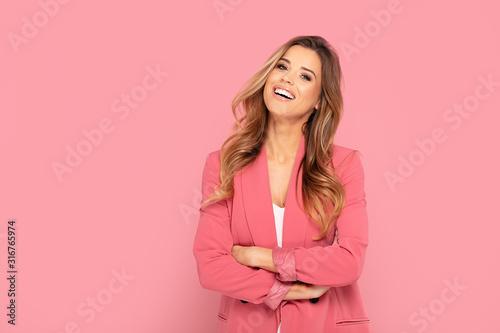 Fototapeta Happy smiling woman on pink background. obraz