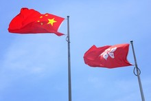 View Of A Chinese Flag And Hong Kong Flag Flying Side-by-side