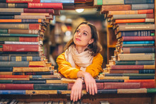 Attractive Young Girl In A Bookstore