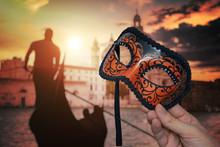Hand Holding Venetian Carnival...