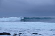 Surfer ride a wave in Unstad beach area which is known as an arctic surfing center located in Lofoten Islands in Northern Norway.